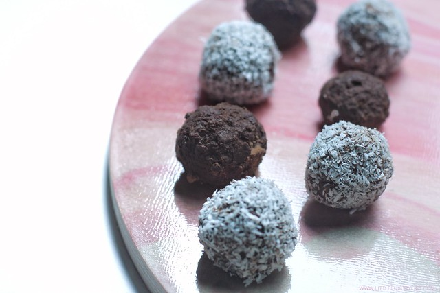 Healthy Chocolate Date Truffles closeup on pink board