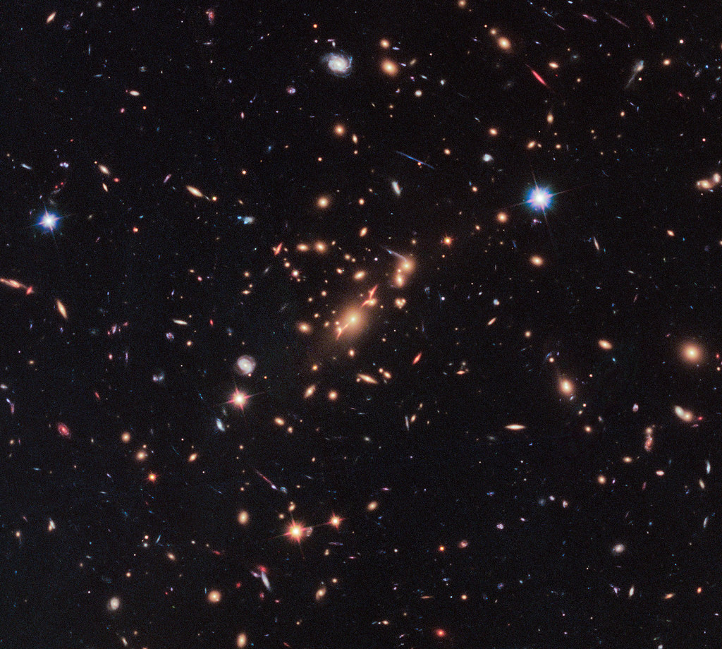 Hubble Uses Gravitational Lens to Capture Disk Galaxy | Flickr