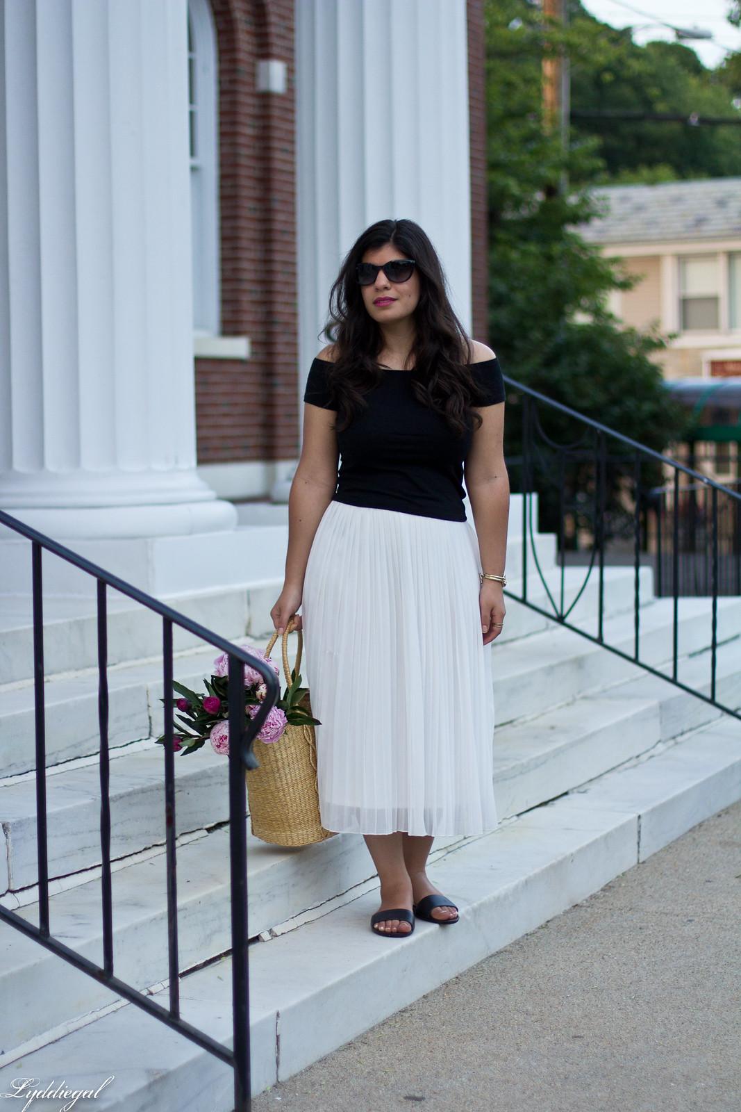 white pleated skirt, black off the shoulder tee, Soak sandals.jpg