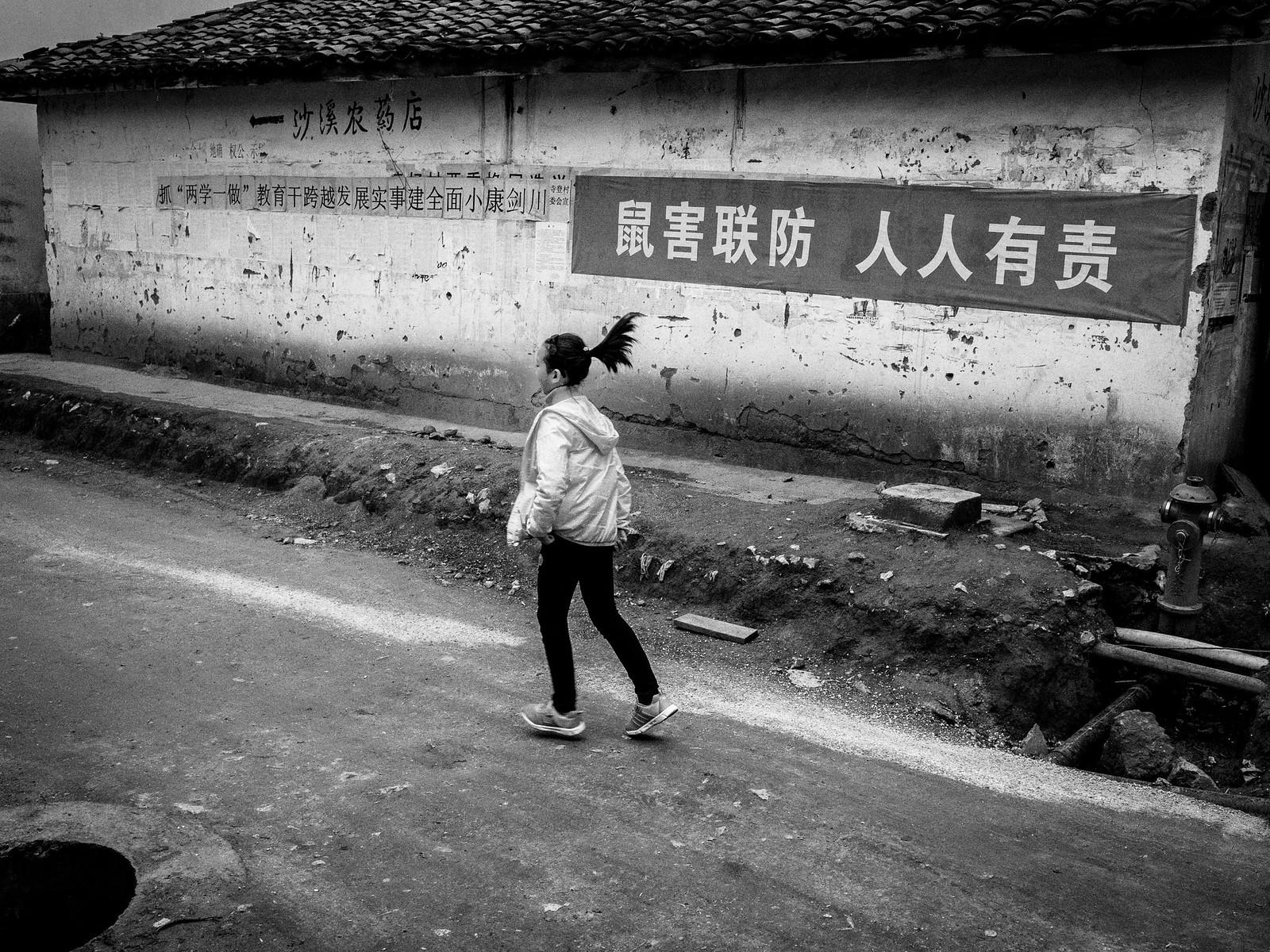girl running from slogans | by tzen xing