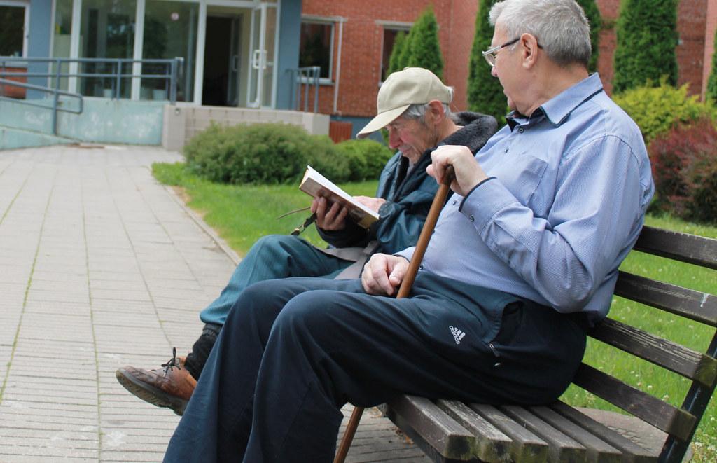 Senior living facility - seniors on a bench
