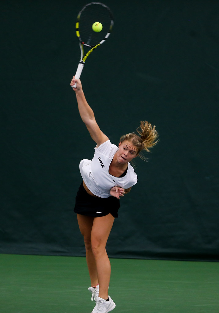 Natalie Looney of the University of Iowa Hawkeye serves during the doubles tennis match.