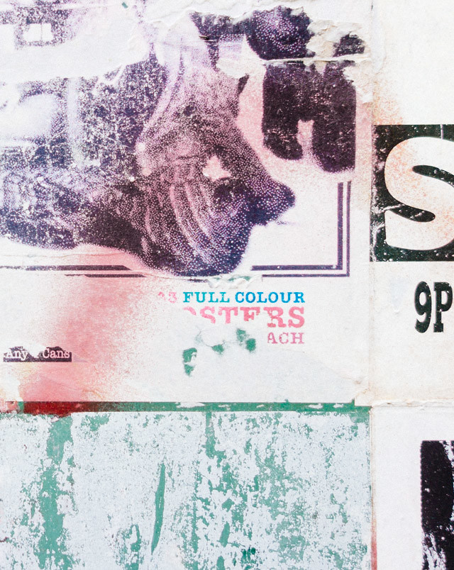 faded graffiti on posters