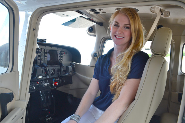 Ashley Tucker sits inside a Cessna Skyhawk 172 airplane.