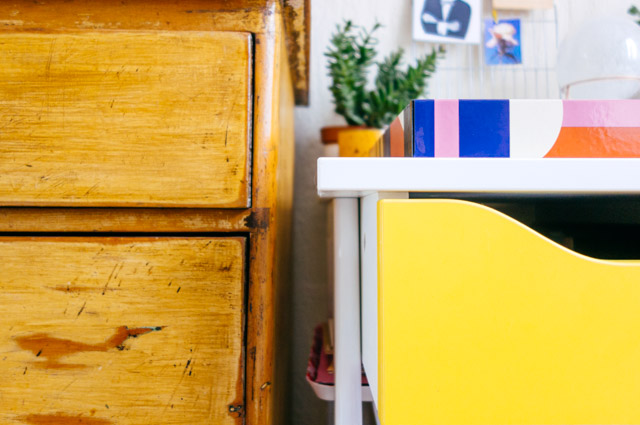 yellow desk drawer next to wooden drawers