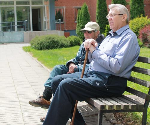 Senior Living Community 2 Seniors Sitting On A Bench Out