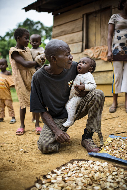 Father with his baby in the village of Ngon, Ebolowa District, Cameroon.