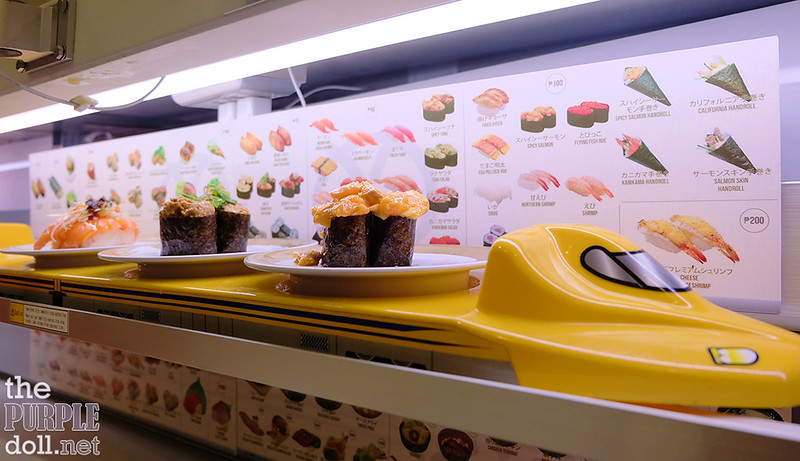 Order sushi via bullet train at Genki Sushi