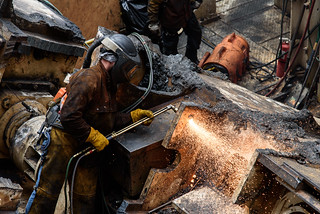 A welder uses a cutting torch during the effort to disassemble the SR 99 tunneling machine.