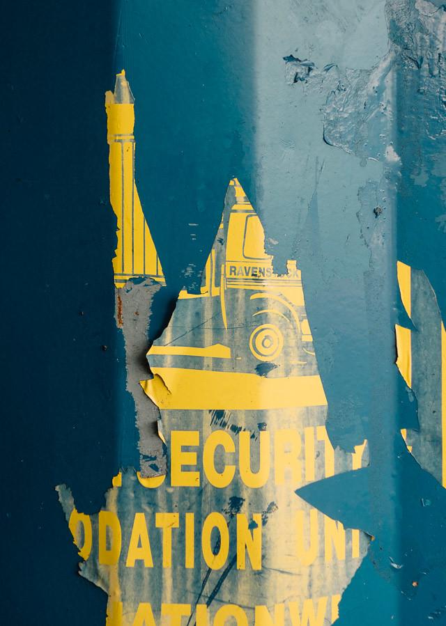 peeling poster on blue