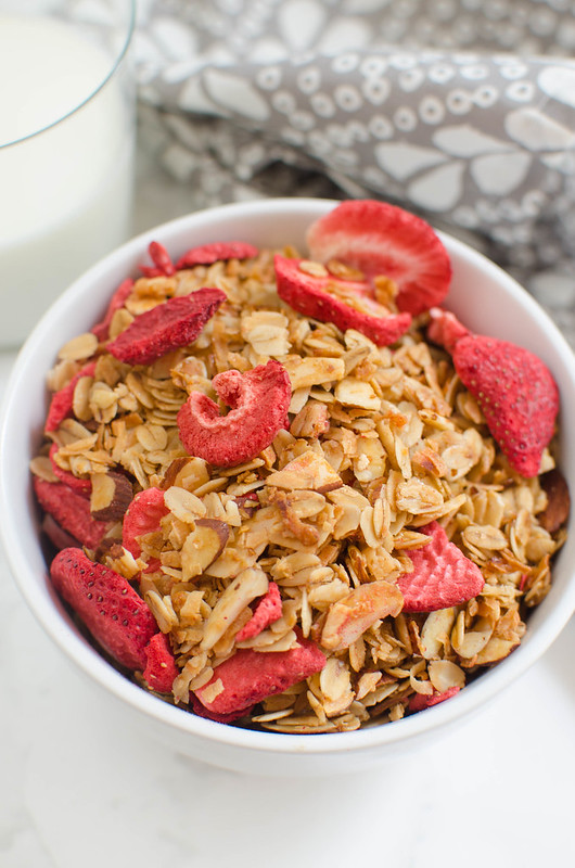 Strawberry Coconut Granola - easy homemade granola recipe! Oats, coconut, sliced almonds, and strawberries!