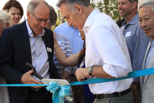 Mercy Housing Northwest president Bill Rumpf (left, center) and King County executive Dow Constantine (right, center) pose for the attempted ribbon-cutting ceremony. Rainier Valley Community Development Fund's Wayne Lau is at the right. | by KelseyHamlin