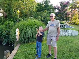 Joseph Eccleston V and Great Grandpa with a nice fish