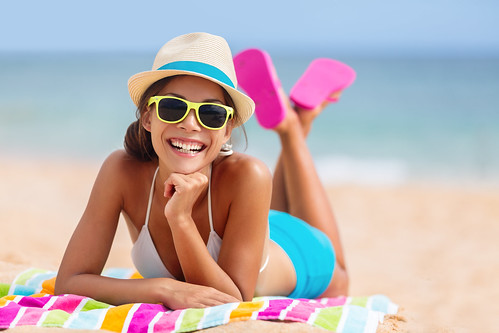 Summer woman relaxing in hipster beach hat and colorful sunglasses. Funky happy girl having fun duri | by ceneje.jeftinije