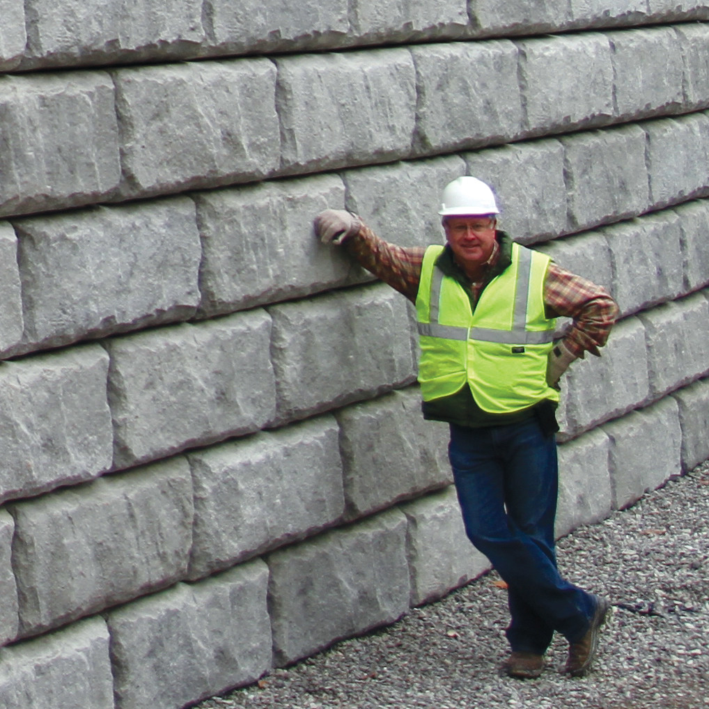 Irvin Vittitow of Redi-Rock KIT by large Redinforced Retaining Wall
