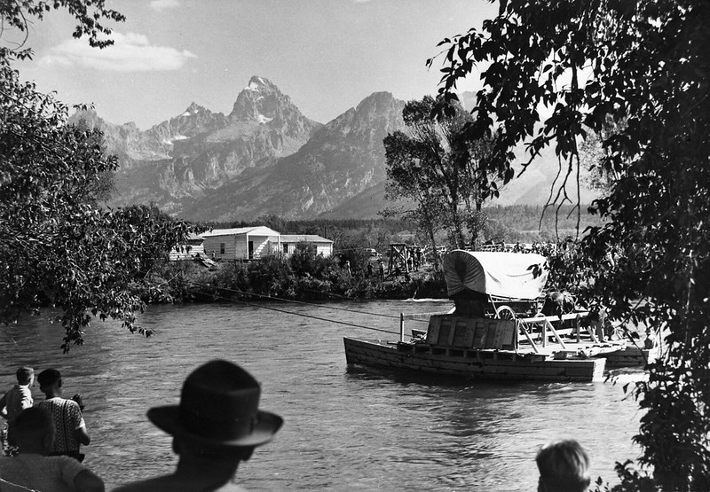 Menor's Ferry after 1950 restoration carrying covered wagon and team of horses across Snake River.