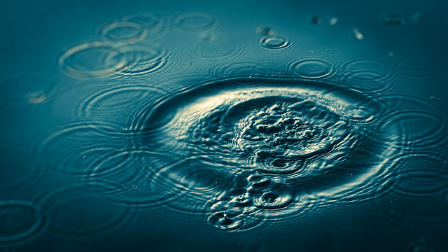 """""""Mathematical Disturbance"""" by Andrew Newill shows concentric ripples in a body of water."""