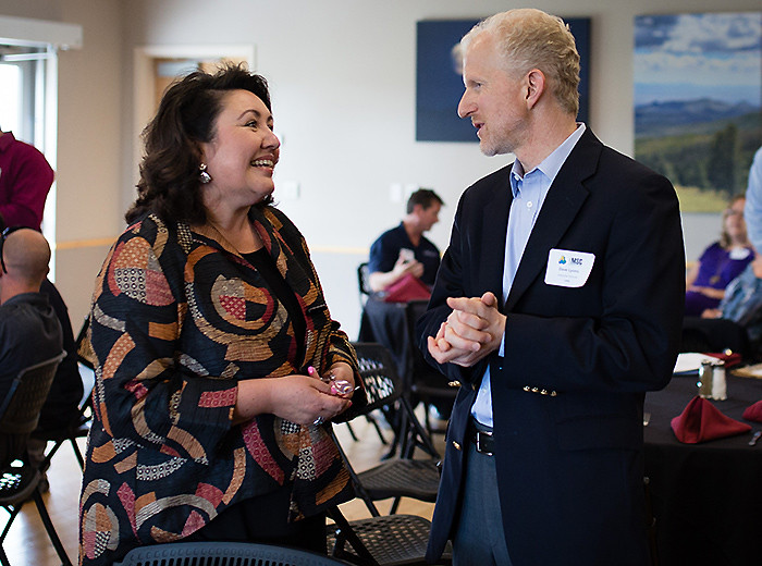 Laboratory Executive Director Dave Lyons talks with Liddie Martinez from Los Alamos National Bank at the MSC Luncheon.
