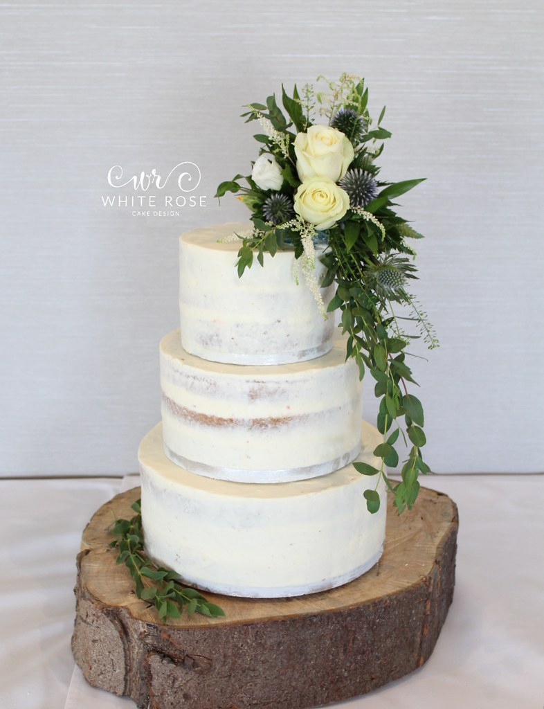 Rustic Semi-Naked Wedding Cake with Fresh Flowers at The F… | Flickr