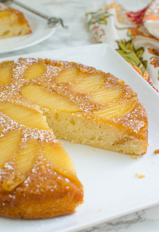 Apple Upside Down Cake - simple and delicious apple cake! Moist cinnamon-spiced cake topped with apples coated in butter and brown sugar.