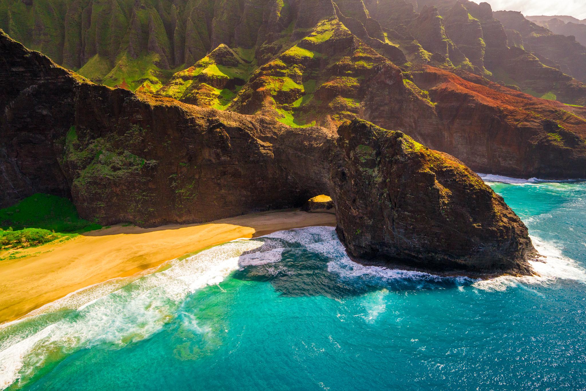 a bird's eye view of the famous napali coast of kauai, hawaii taken