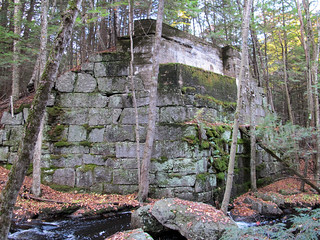 a photograph of a large granite bridge abutment, without an accompanying bridge