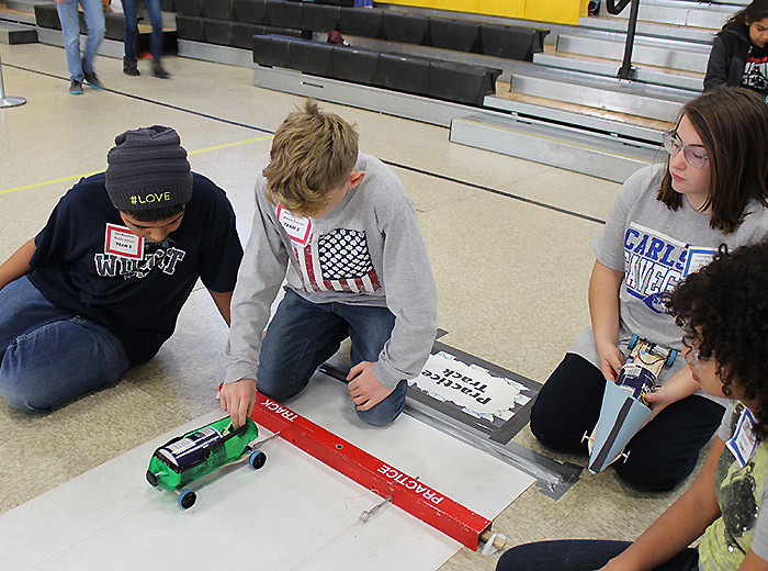 Students prepare their car to race at last year's Electric Car Challenge held at Albuquerque's Van Buren Middle School.