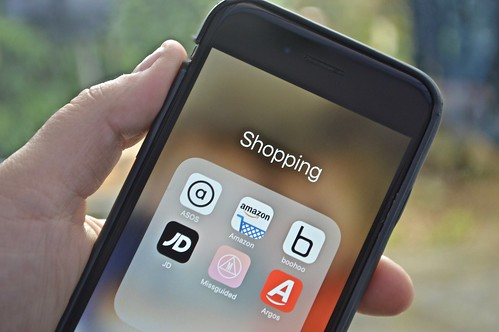 M-Commerce Ecommerce Shopping Apps on an iPhone Screen | by shopblocks