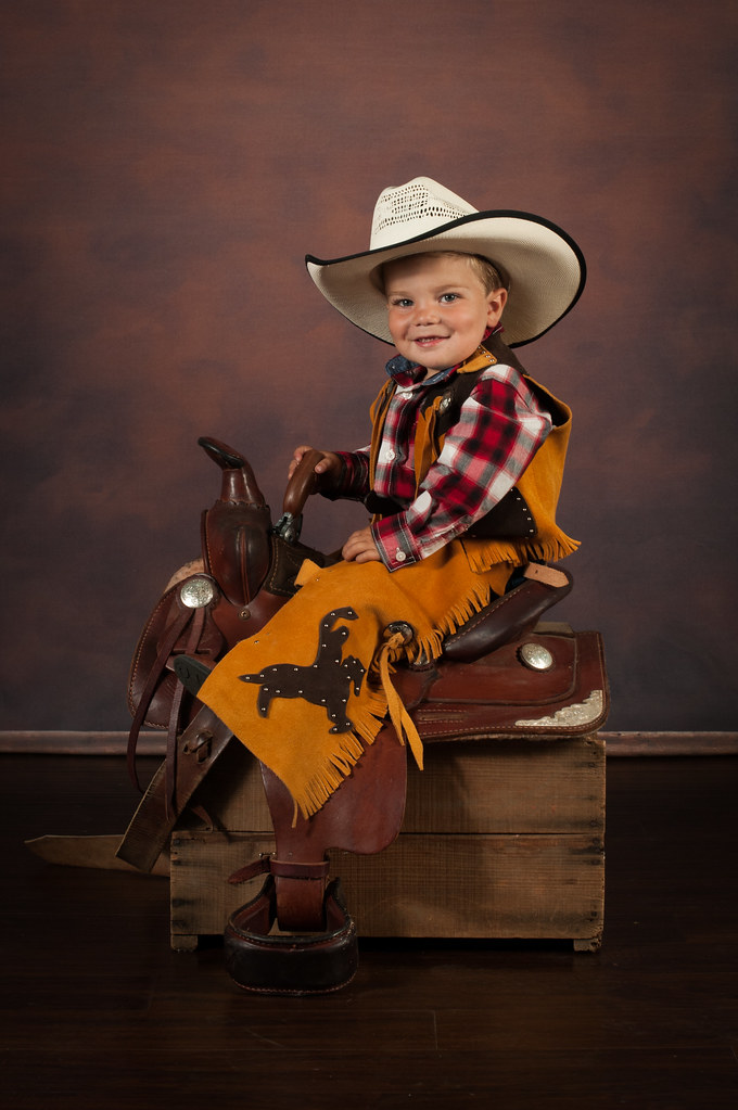 His Mom has done the same two year old pictures with her other two boys in  this darling cowboy outfit! He has the most amazing blue eyes and long  eyelashes ... 5733f414ed0