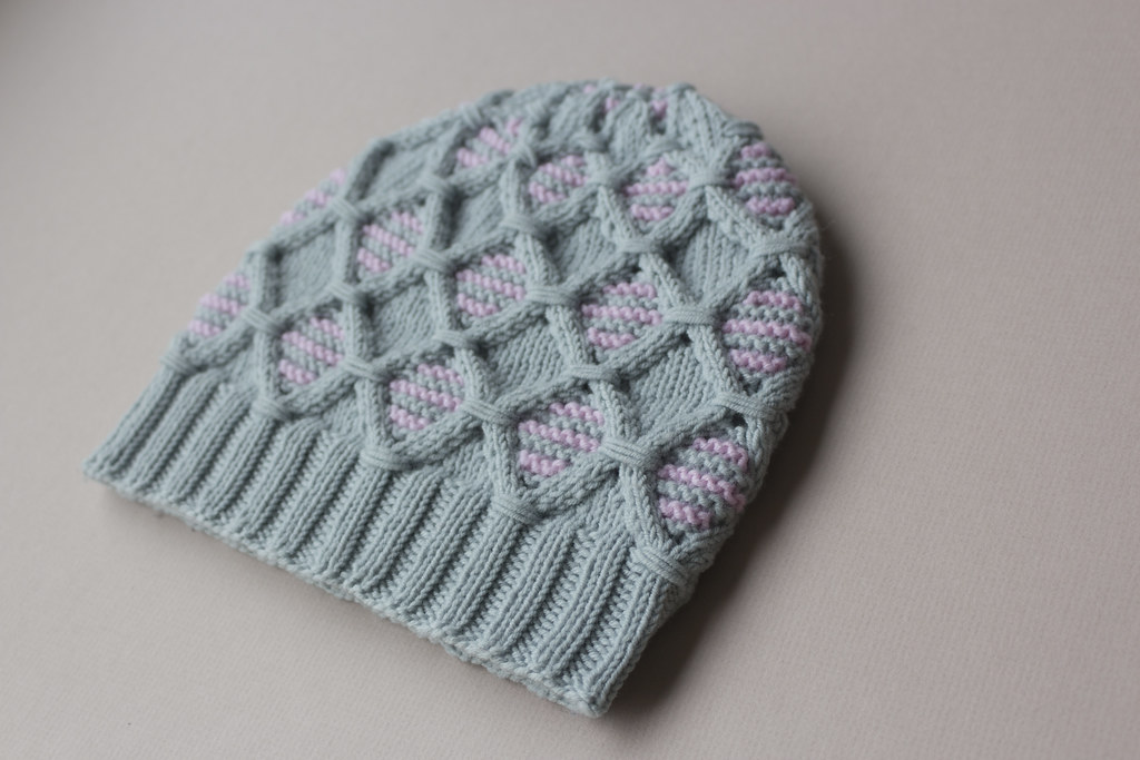 grey and pink cabled hat