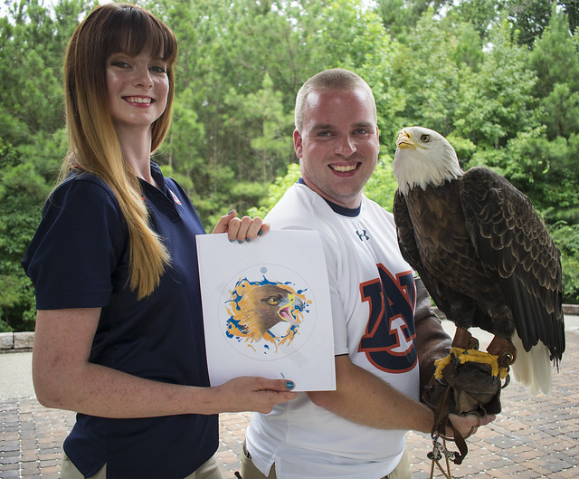 Robyn Miller and Andrew Hopkins pose with Spirit.