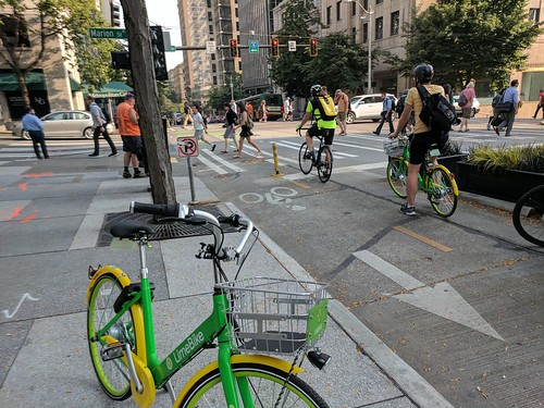 Lime bike waits near the 2nd Ave protected bike lane @ Marion | by Seattle Department of Transportation