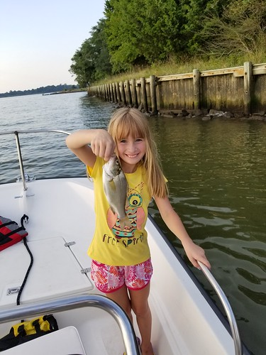 Lila Couslin with a White Perch