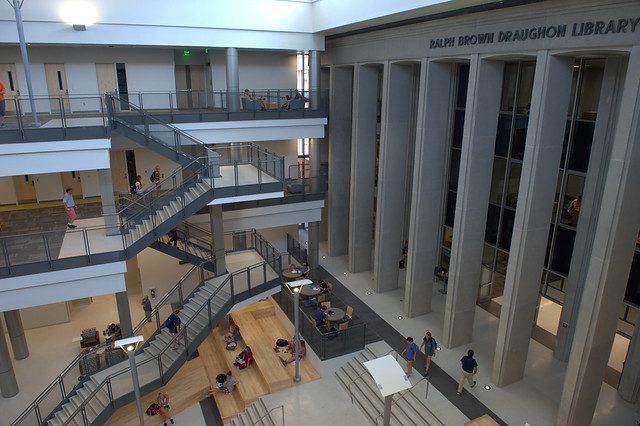 Photo shows the staircase of the Mell Classroom Building alongside the original façade of the Ralph Brown Draughon Library.