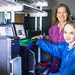 "Scientists at Los Alamos National Laboratory are improving the identification of the bacterium that causes tularemia (""rabbit fever"") and considered a ""Category A"" bioterrorism agent by the Centers for Disease Control and Prevention. At left, principal investigator Jean Challacombe, assisted by Cheryl Gleasner who runs the sequencing machines, and who participated in the sequencing of most, if not all, of the Francisella genomes sequenced at Los Alamos. The device shown is an Illumina NextSeq 500, used in high-throughput sequencing in the laboratory."