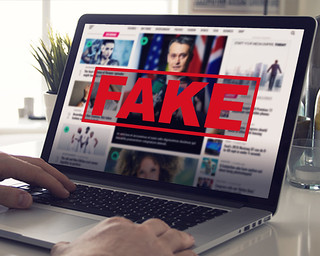 Fake News - Computer Screen Reading Fake News | by mikemacmarketing
