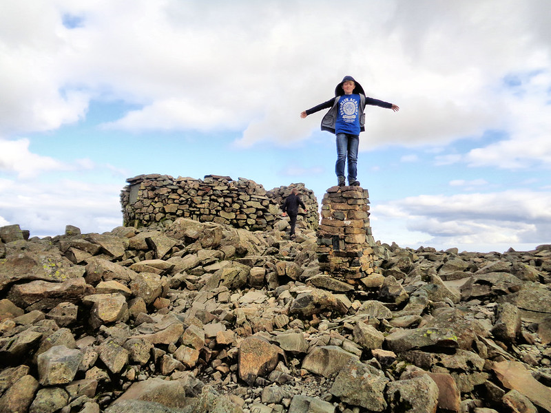 Sam posing on the Scafell Pike trig point