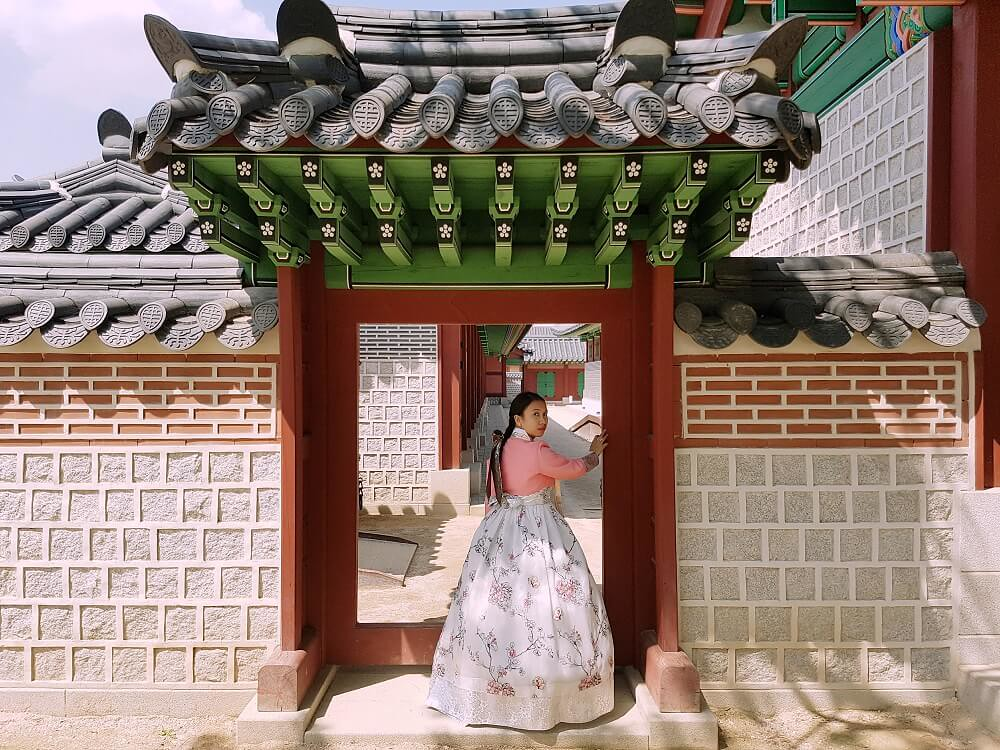 exploring gyeongbok palace wearing a hanbok