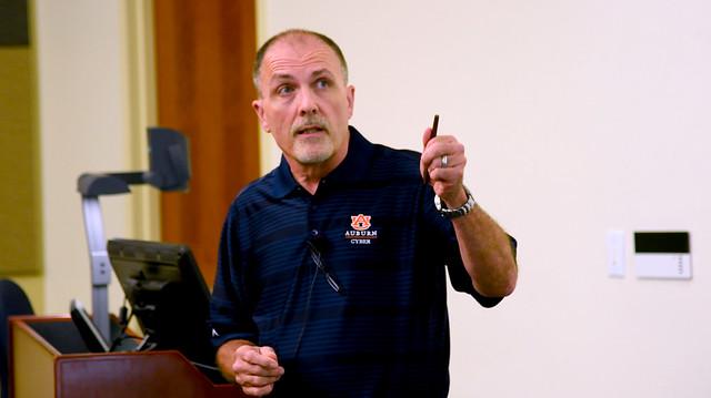 David Umphress is shown talking to a class.