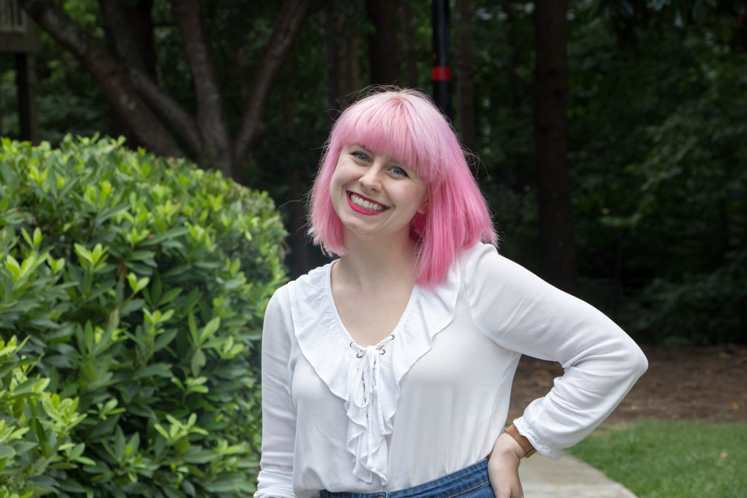 Pastel Pink Hair with Bangs and a White Shirt