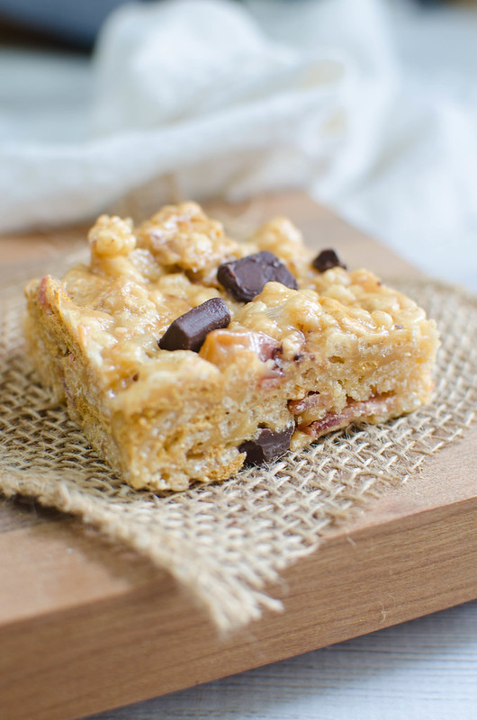 Peanut Butter Bacon S'mores Crispy Treats are the perfect mix of sweet and salty! A yummy mix of crispy rice cereal and golden grahams are coated in peanut butter and melted marshmallows and then tossed with crispy bacon and chocolate chunks.