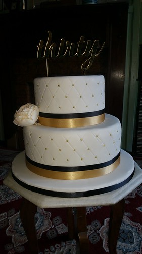 Two tiered gold/black birthday cake. | by platypus1974