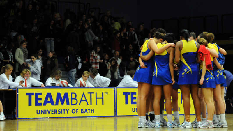 TeamBath netball team standing in a huddle on the court
