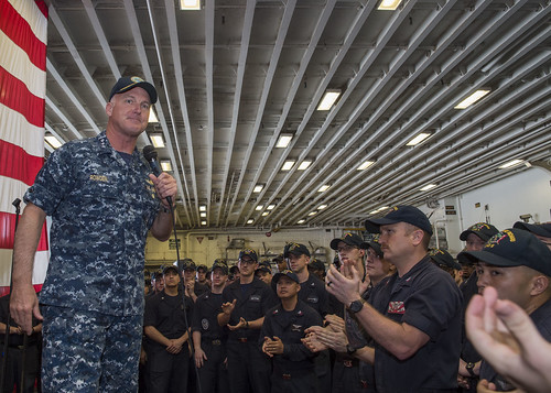 Vice Adm. Tom Rowden, commander, Naval Surface Forces, addresses Sailors during an all-hands call in the ship's hangar bay of the amphibious assault ship USS Bonhomme Richard (LHD 6).