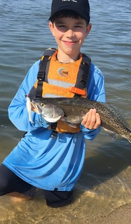 Nicklas Long is all smiles with this speckled trout he caught