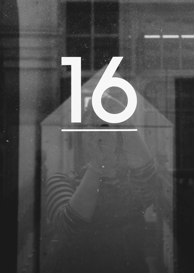 number 16 on glass door