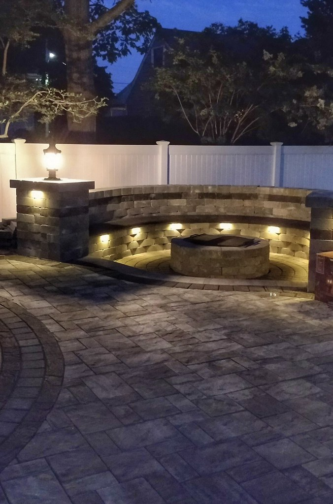cambridge paver seatwall with firepit and led lighting flickr