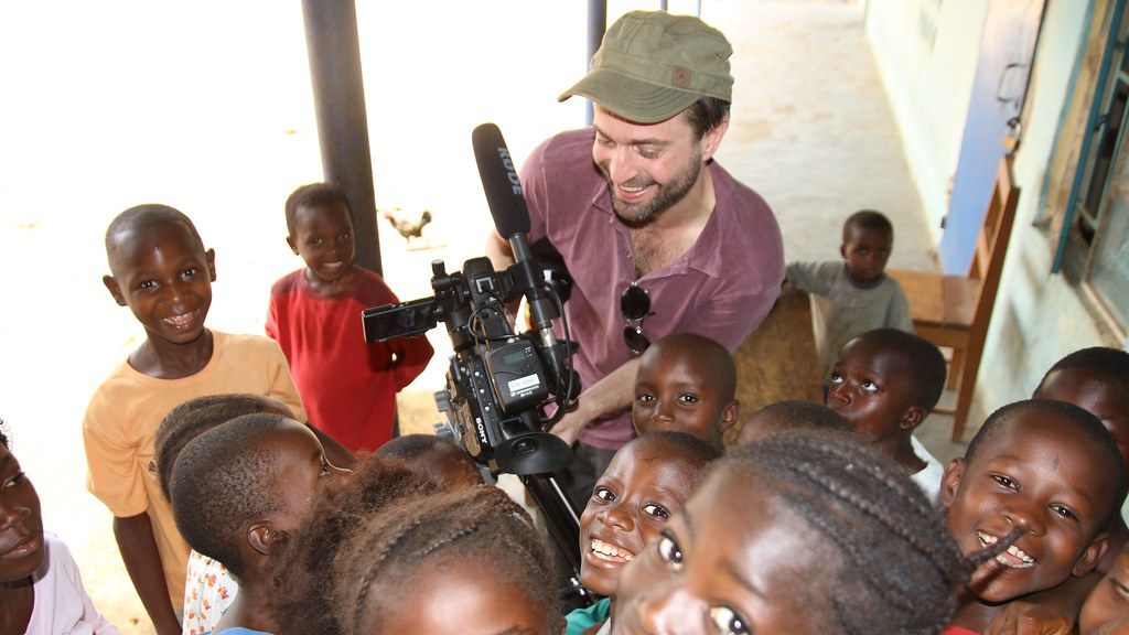 Photograph of a camera man with children