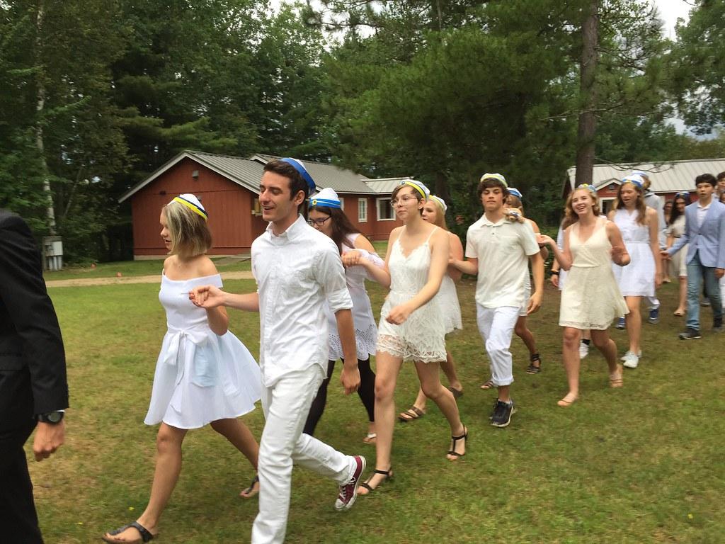 Graduating Sjölunden students parade through camp