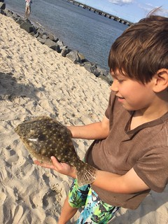 Alex King and a small flounder he released